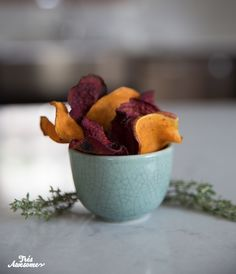 BEET AND SWEET POTATO CHIPS Ingredients: 3 large beets, peeled 3 large sweet potatos 4 tablespoons olive oil Sea Salt Cracked Pepper