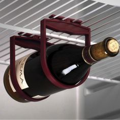 Refrigerator Wine Holder ($8, odditymall.com) Hang wine bottles horizontally from the bottom of wire shelves frees up valuable shelf space, and keeps them from rolling around.