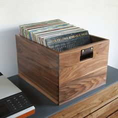 Store up to 100 LPs in a beautiful handcrafted walnut crate with leather handles.