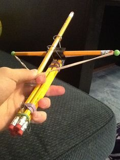 Functioning crossbow made of pencils and rubber bands
