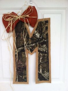 Hey, I found this really awesome Etsy listing at http://www.etsy.com/listing/128068624/camouflage-and-burlap-initial-with