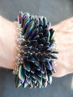 Peacock dagger bead cuff bracelet with four strand slide clasp via Etsy