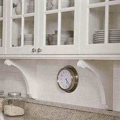 Soften wall hung cabinets by mimicking details found elsewhere in your vintage home; like these brackets