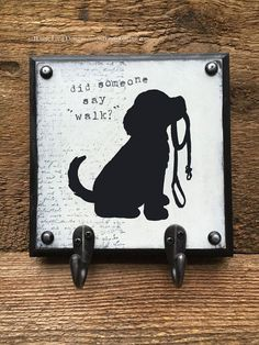 Dog Art Leash Holder, hook, hanger with hand painted dog silhouette and phrase, Did someone say walk? available in one, two, or three hook styles and your choice of six colors -- SIZE: ------------------------------------------------------- SINGLE HOOK: 3.5 x 7 x 1 DOUBLE HOOK: 7 X 7 X 1 TRIPLE HOOK: 6 X 14 X 1 DETAILS: -------------------------------------------------------- -comes ready to hang with sawtooth hanger and rubber bumpers to protect your wall -hook base is solid lightweight…