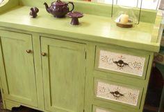 Mueble en madera maciza, pintado y con terminación en técnica decapado. Dos puertas con un estante y tres cajones con aplicaciones de vidrio de vitral cortado a mano formando una figura (Técnica de mosaiquismo). Color verde claro. Se puede realizar en otros colores a elección. Medidas: 1.20m de ancho x 0.80m de altura x 0.35m de profundidad. Color Verde Claro, T Home, Chalk Paint, Diy Furniture, Buffet, Vanity, Cabinet, Storage, Kitchen