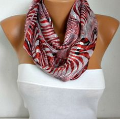 I would wear this scarf with a black sweater. It would also go well with either a white or black jacket.