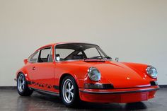 Back when Porsche was air cooled, here's the 1973 911RS.  Porsche in it's purest state . . .