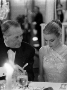 Maurice Chevalier talks with Grace Kelly at the 1956 Academy Awards