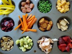 yummy snacks: TOP (left to right) yellow bell pepper, cooked hot dogs, peas, cheese MIDDLE (LR) pomegranate seeds or red grape halves, carrots, peanut butter crackers, white chocolate BOTTOM (LR) animal crackers or herb crackers, herbed popcorn, turkey, strawberries