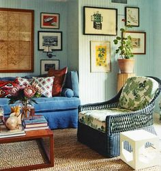 Mix-n-match colors and prints with a photo wall.  I love the framed map.  Link leads to 50 Ideas To Decorate Walls With Photos