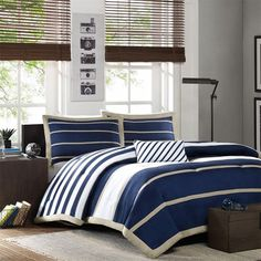 Comforter and pillow shams in navy blue and white stripes