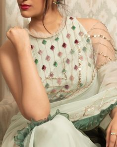 Sage green embellished saree with halter neck blouse. Launching Festive Saree Collection for the Festive and Wedding season. Kurti Embroidery Design, Embroidery Suits, Embroidery Fashion, Kurta Neck Design, Blouse Designs Silk, Kurta Designs Women, Pakistani Dress Design, Embroidered Clothes, Beautiful Blouses