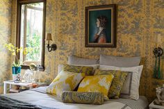 In the guest bedroom, Powers chose a traditional Pierre Deux toile pattern, but the overall effect feels more playful than proper thanks in part of the portrait hanging above the bed.