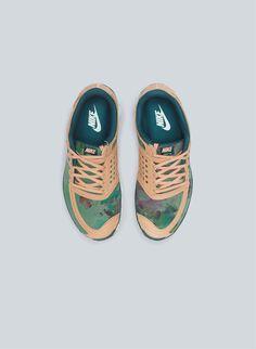 Nike Free 5.0 Liberty. http://www.dazeddigital.com/fashion/article/16094/1/christopher-raeburn-on-camouflage this pair is nice:)