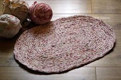 "Braided Rag Rug DIY : detailed DIY, including how she makes T-shirt ""yarn""."