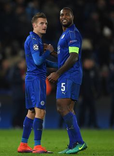 Jamie Vardy and Wes Morgan of Leicester City celebrate their teams 2-1 victory after the UEFA Champions League Group G match between Leicester City FC and Club Brugge KV at The King Power Stadium on November 22, 2016 in Leicester, England.