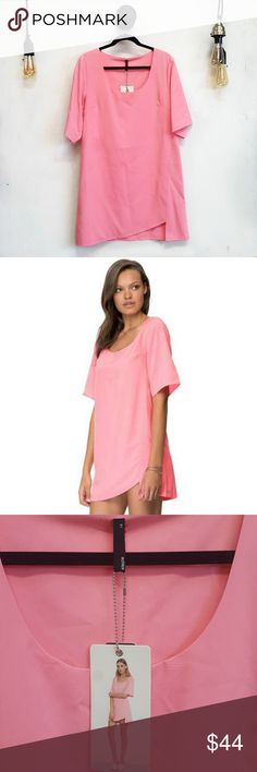 NWT Bubblegum Pink Asymmetric Hem Tee Dress NWT Bubblegum Pink Asymmetric Hem Tee Dress. This is such a gorgeous and unique dress. Bright, fresh, sexy and fun.  New with tags, just has a small pin hole on the back of the neck (pictured)  Measurements: Length from armput Bust Staple Dresses Mini