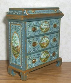 It is signed and dated - Leslie Lassige (that's me!). on the bottom. The latest, a Bespaq chest of drawers I bought unfinished. I've hand painted it with six tiny landscapes in the ovals, lots of gold detailing, and florals and flourishes. | eBay!