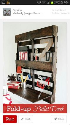 Awesome idea! Repurposing a wood pallet as a fold-down desk