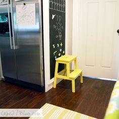 Yellow IKEA BEKVÄM step stool, blackboard paint, chalk, kitchen, wooden floors, stainless steel fridge