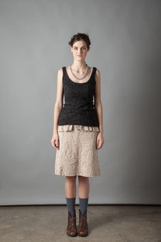 """100% organic medium-weight cotton jersey Maxine Skirt with backstitch reverse appliqué in our Magdalena stencil. Fitted at waist with a slight flare to hem. Measures 23"""" in length. Shown here in Nude. Choose your color below.Please allow four to six weeks for delivery. Wash gently + Hang to dry. Free domestic shipping. Made in the USA."""