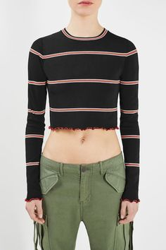 Bring your look into focus for spring/summer with the Margot Crop Top. Wrapped in a retro stripe detailing, this slinky crop top is finished with girly lettuce stitching at the hems.