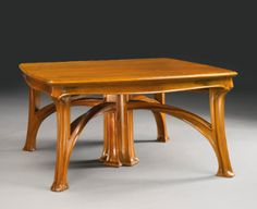Louis Majorelle Dining Table in Walnut with three extension leaves. France, circa 1900 - Sotheby's