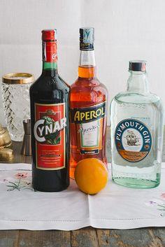 The Stolen Negroni 1 oz Gin 1 oz Cynar 1 oz  Aperol Orange for garnish Shake with ice. Strain into cocktail glass.