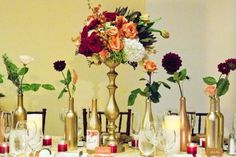 Use matte or metallic gold spray paint, Inspiring centerpiece idea would be to spray paint regular wine bottles and use them throughout the venue as vases
