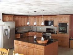 Split level kitchen remodel on a budget, This 70s split level had the typical dark small kitchen, complete with cheesy plywood front cabinets with particle board frames and plastic draws. One wall removed makes a big diference! Yes it was  load-bearing. , Kitchens Design