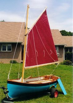 9 foot sailing dinghy with sails up