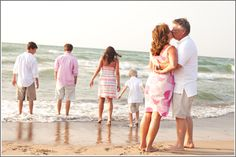 Family portrait photography on the beach in Northwest Indiana. Love the pink and white and khaki! At Beachwalk Resort, Michigan City, Indiana.