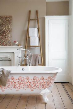 A floral stencil adds a colorful focal point to a neutral bathroom. Bath Ideas, Bathroom Ideas, Furniture Makeover, Cool Furniture, Master Suite, Master Bath, Victorian Bath, My Ideal Home, Neutral Bathroom