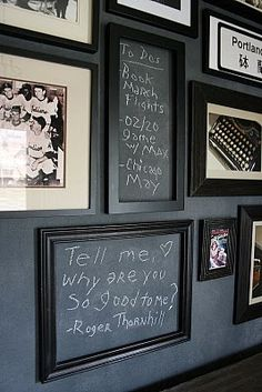 Empty frames on chalkboard wall mixed in with pics on gallery wall.