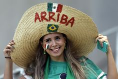 A Mexican supporter smiles before the World Cup round of 16 soccer match between the Netherlands and Mexico at the Arena Castelao in Fortaleza, Brazil, Sunday, June 29, 2014.