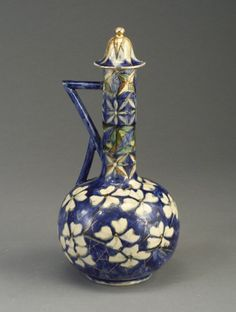 Unusual early Rookwood jug, painted with dogwood flowers on a cobalt ground in underglaze slip colors, 1885.