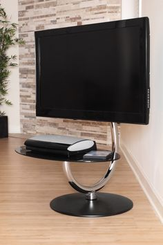 The LumiSource 360 TV Stand adjusts to fit your flat screen television. This sleek, modern piece fits most flat paneled TVs 15 to 50 inches in size. Unique Tv Stands, Cool Tv Stands, Tv Stand Room Divider, Large Screen Tvs, Flat Screen, Support Tv, Modern Entertainment Center, Swivel Tv Stand, Tv Rack