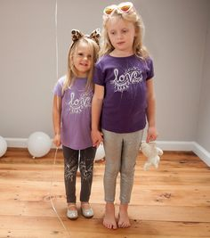 Little girls will love our hand printed t-shirt in vibrant lavender. Each one is hand painted with silver glitter to reflect your childs sparkling energy!  Fit: 2T - Body Length 15.5, Width 11, Sleeve 2.25, 4T - Body Length 17.5, Width 12.5, Sleeve 3,  Sizing: Toddler GIrl, Cap Sleeve, Longer Length  Materials: 100% combed ringspun cotton jersey, topstitched, ribbed collar, taped neck. Double-needle hem sleeves and bottom.  Decoration: Our one of a kind love graphic is screen printed by hand…
