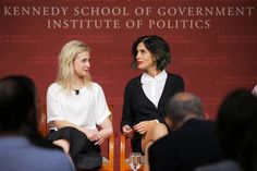 Maria Alyokhina and Nadezhda Tolokonnikova, members of the punk protest band Pussy Riot, take their seats onstage for a forum at the Kennedy School of Government at Harvard University in Cambridge, Massachusetts