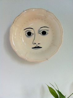 it could be kinda funny or creepy to have a bunch of dishes with different faces on them...  Tribute to Fornasetti by ilustrista, via Flickr