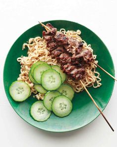 Grilled-beef skewers are accompanied by ramen noodles dressed up with a peanut-ginger sauce.