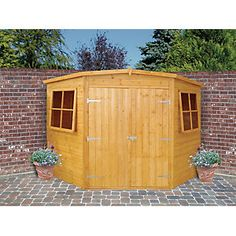 Shire Corner Shed Double Doors is an excellent quality corner garden shed featuring easy access, high quality and low cost Shiplap Sheds, Shiplap Cladding, Pergola With Roof, Diy Pergola, Types Of Cladding, Log Cabin Sheds, Corner Sheds, Free Shed Plans, Corner Garden
