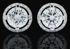 A pair of diamond earrings, by Canturi  The brilliant-cut diamonds, weighing 2.06 and 2.01 carats each, set within a diamond-set surround, with posts and butterfly clips, mounted in 18 carat white gold, signed Canturi, maker's case