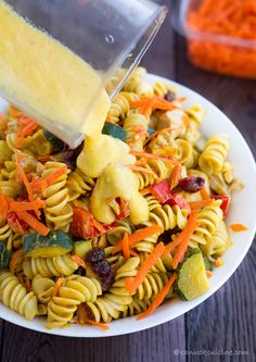 Chicken pasta salad recipe with yogurt & pureed mango for the sauce. Lots of sauteed zucchini and red peppers, just like my local organic market makes it.