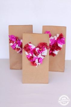 Tissue Paper Heart Bags Do your kiddos have to create their own valentine bag to collect goodies from their school Valentine's Day Party? Make Tissue Paper Heart Bags, at home. Valentines Card Holder, Valentines Day Bags, Kinder Valentines, Valentines Day Activities, My Funny Valentine, Paper Bag Crafts, Tissue Paper Crafts, Paper Bags, Felt Crafts