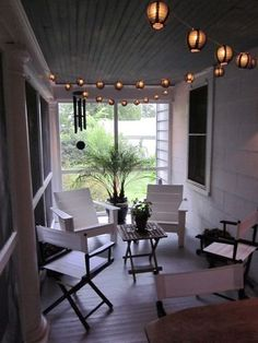 A screened-in porch is an excellent setting for string lights with a paper shade, because you don't have to worry about them getting wet. The Paper Lantern Store offers beauties identical to the black shades shown here.