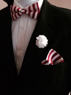 Red and white stripped bow tie and white lapel flower combination. Available now from Anointed Accessories.