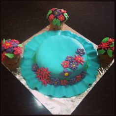 Hat shaped cake!! With flowerpot cupcakes...