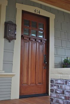 Door Trim number and mailbox...very cool! Phinney Ridge Porch & Craftsman door with a teak stain. | Ideas for Upcoming Home ...