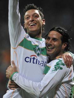 Mesut Özil and Claudio Pizarro